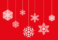 Hanging snowflakes on a red background vector Royalty Free Stock Image