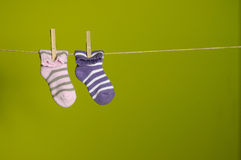 Hanging socks. On green background Stock Images