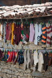 Hanging socks. Knitted socks hanging on a house facade Stock Photography