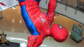 A hanging Spider-Man figurine displayed at a Bangkok shopping-mall stock footage
