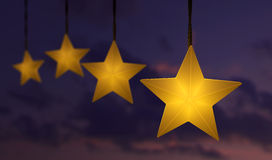 Hanging star string lights over sky Royalty Free Stock Image