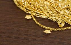 Hanging stars gold bracelet. Gold bracelet with hanging stars  on wood background Royalty Free Stock Photography
