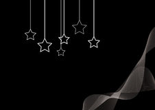 Hanging stars on the black wallpaper Stock Photo