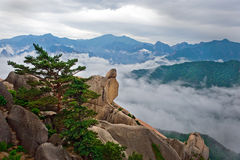 Hanging stone at the Ulsanbawi Rock against the fog seorak mount Royalty Free Stock Images
