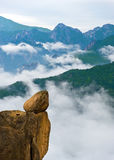 Hanging stone at the Ulsanbawi Rock against the fog seorak Stock Photos