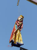 Hanging by a string. Traditional Rajasthan wooden puppet for sale in Udaipur Royalty Free Stock Photo