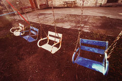 Hanging swing seats with vintage effect Royalty Free Stock Photography