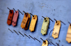 Hanging tags in factory setting Royalty Free Stock Image