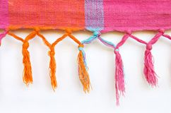 Hanging tassles. Woven coloured material with hanging knotted tassles Stock Image
