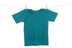 Hanging Tee shirt. A bright colored Tee Shirt hanging on a clothesline Stock Image