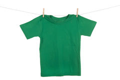 Hanging Tee shirt. A bright colored Tee Shirt hanging on a clothesline Stock Images