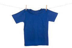 Hanging Tee shirt. A bright colored Tee Shirt hanging on a clothesline stock photography