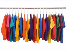Hanging Tee shirts. Bright colored Tee Shirts hanging on a clothesline Royalty Free Stock Photography