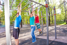 Hanging teenagers on the brachiating bar Royalty Free Stock Image