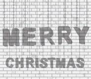 Hanging Text Christmas  on brick wall Royalty Free Stock Image