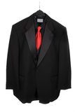 Hanging three piece suit with red tie Royalty Free Stock Photos