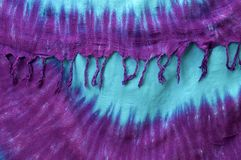 Hanging tie dye background with tassels on edge stock photography