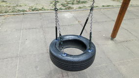 A hanging tire. On a playground royalty free stock photography