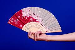 Hanging on to japanese fan Royalty Free Stock Images