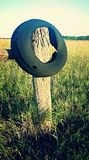 Hanging On To The Open Road. Tires are not the typical yard decorations but we gotta find someway to hang on to the dreams of the open road Royalty Free Stock Photo