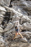 Hanging on to the rock. Royalty Free Stock Images