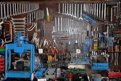 Hanging Tools. Many well-organized & well-used tools hang on a peg board in a garage Royalty Free Stock Photos