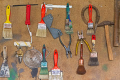 Hanging Tools on Wood Panel Stock Photo