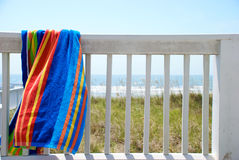 Hanging Towel. A beach towel drying on the porch on a hot summer day Royalty Free Stock Image