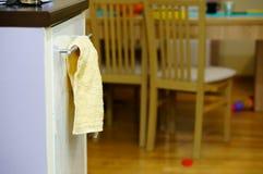 Hanging towel. By closet indoors stock photos