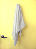 Hanging Towel Yellow door Royalty Free Stock Photo