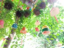 Hanging tree with decorative ceramic bell stock illustration