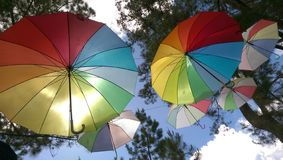 Hanging Rainbow Umbrella at Gayo Highland Park, Central Aceh, Indonesia stock photo