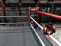 Hanging up boxing gloves. A pair of black and red boxing gloves hung up on the perimeter lines of a boxing ring in an old boxing club Stock Photos