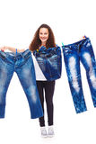 Hanging up denim clothes Royalty Free Stock Image