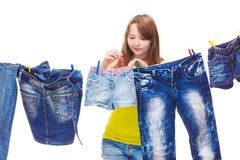 Hanging up denim clothes Stock Photos