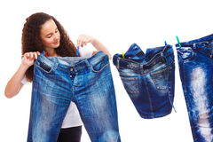 Hanging up denim clothes Stock Photo