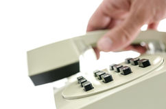 Hanging up a telephone handset Stock Photography