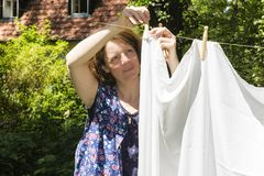 Hanging up the washing in Royalty Free Stock Photo