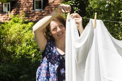Hanging up the washing in Stock Photo