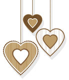 Hanging Valentine's hearts. Three hanging Valentine's hearts in brown Royalty Free Stock Photos