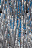 Hanging Vertical Group of Silver Plastic Pipe and Blue Sky in Ba Stock Photos