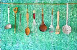 Hanging vintage kitchen utensils Royalty Free Stock Images