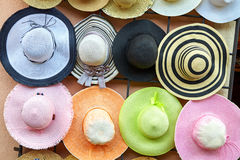 Hanging on the wall of colorful straw hats Royalty Free Stock Photo