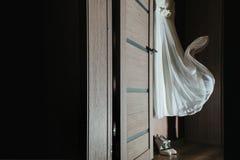 Hanging on the wardrobe wedding dress stock images