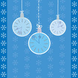 Hanging watches on blue background with snowflakes Stock Photo