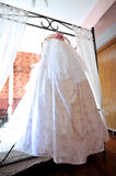 Hanging Wedding Dress Stock Photo