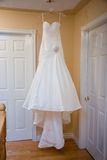 Hanging Wedding Dress. Wedding Dress hanging before the wedding royalty free stock photos