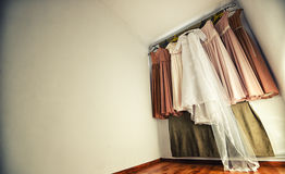 Hanging wedding dress and bridesmaid dresses Royalty Free Stock Photo