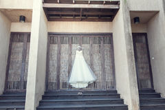 Hanging wedding dress Stock Image