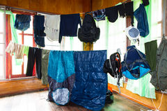 Hanging wet clothes and camping equipments Royalty Free Stock Photography